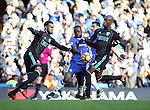 Chelsea's Vicotr Moses tussles with WBA's Allan Nyom and Matt Phillips during the Premier League match at Stamford Bridge Stadium, London. Picture date December 11th, 2016 Pic David Klein/Sportimage