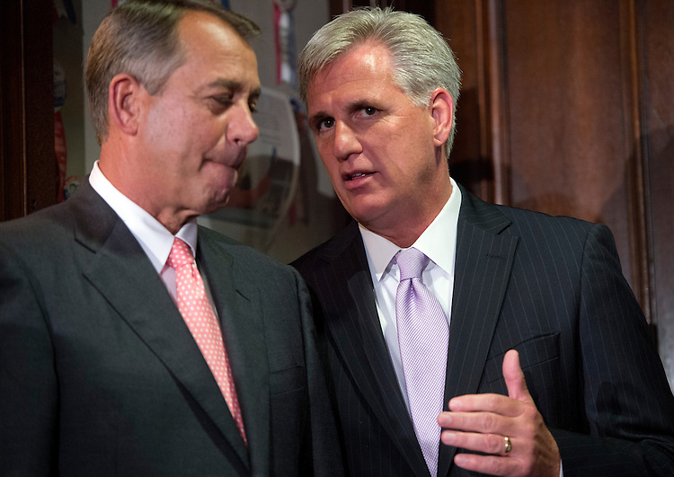 UNITED STATES - JULY 17: Speaker John Boehner, R-Ohio, talks with House Majority Whip Kevin McCarthy, R-Calif., during a news conference at the RNC after a meeting of the House Republican Conference. GOP leaders addressed issues including the health care law and immigration reform. (Photo By Tom Williams/CQ Roll Call)