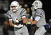 Oceanside No. 9 James Paczkowski, left, takes a handoff from quarterback No. 18 Vincent Guarino during a Nassau County varsity football Conference I semifinal against Massapequa at Hofstra University on Saturday, Nov. 14, 2015.<br /> <br /> James Escher
