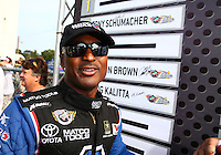 Aug. 18, 2013; Brainerd, MN, USA: NHRA top fuel dragster driver Antron Brown during the Lucas Oil Nationals at Brainerd International Raceway. Mandatory Credit: Mark J. Rebilas-