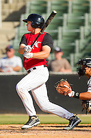 Mark Haddow #21 of the Kannapolis Intimidators follows through on his swing against the Hickory Crawdads at CMC-Northeast Stadium on April 8, 2012 in Kannapolis, North Carolina.  The Intimidators defeated the Crawdads 12-11.  (Brian Westerholt/Four Seam Images)
