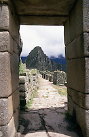 An archway in Machu Picchu looking through to Intihuatana (the Hitching Post of the Sun).