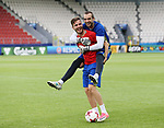 Spain's Saul Niguez carries Pau on his back during training at the Stadion Cracovia in Krakow. Picture date 29th June 2017. Picture credit should read: David Klein/Sportimage