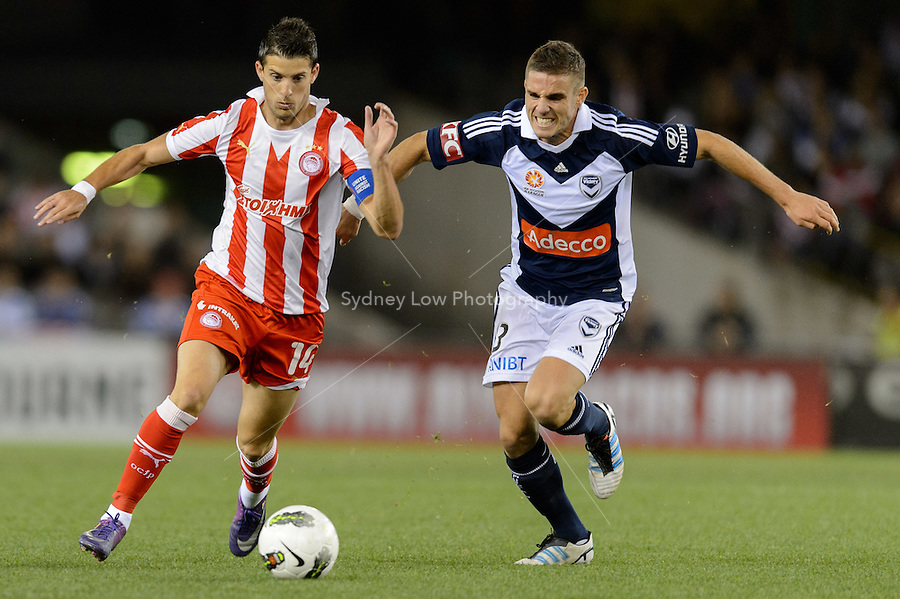 MELBOURNE, AUSTRALIA - MAY 19: Kevin Mirallas of Olympiakos and  Diogo Ferreira of the Victory compete for the ball during a match between Melbourne Victory and Olympiakos FC at Etihad Stadium on 19 May 2012 in Melbourne, Australia. (Photo Sydney Low / AsteriskImages.com)