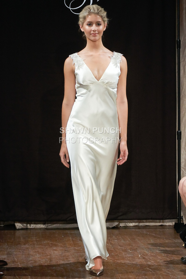 "Model walks runway in a Deja Bridal dress - V-neck crepe back satin gown with beaded applique, by Sarah Jassir, for the Sarah Jassir Spring 2013 ""La Reve: The Dream"" collection, during Bridal Fashion Week New York."