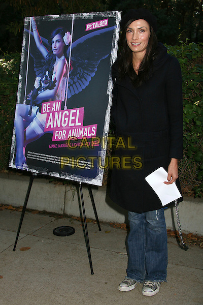 "FAMKE JANSSEN.Famke Janssen Unveils ""Be An Angel For Animals"" PETA Ad at Runyon Canyon Park, Hollywood, California, USA,.19 December 2006..full length black hat coat jeans poster.CAP/ADM/BP.©Byron Purvis/Admedia/Capital Pictures"