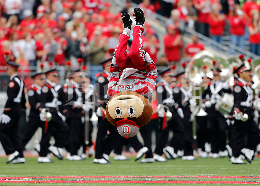 Brutus does a backflip at midfield as the Ohio State Marching Band takes the field prior to the NCAA football game at Ohio Stadium in Columbus on Sept. 21, 2013. (Adam Cairns / The Columbus Dispatch)