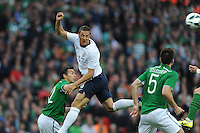 29.05.2013 London, England. Phil Jagielka, England, heads clear above Stephen Kelly, Republic of Ireland, during the International Friendly between England and Republic of Ireland from Wembley Stadium.