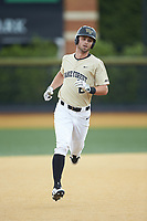 Jake Mueller (6) of the Wake Forest Demon Deacons rounds the bases after hitting a home run against the Virginia Cavaliers at David F. Couch Ballpark on May 19, 2018 in  Winston-Salem, North Carolina.  The Demon Deacons defeated the Cavaliers 18-12.  (Brian Westerholt/Four Seam Images)