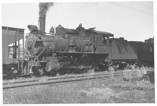 3/4 fireman's-side view of MT #57 as pusher on freight.<br /> Midland Terminal