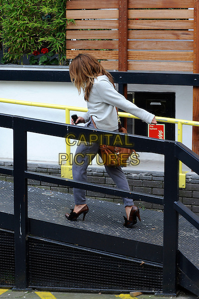 BILLIE PIPER .Arriving at the London Studios, London, England..April 15th, 2010.full length car grey gray top mulberry satchel bag brown trousers joggers profile heels shoes.CAP/IA.©Ian Allis/Capital Pictures.