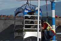 10-8-2014: With close on 20,000 people watching King Puck, a wild mountain goat is hoisted 60ft above his 'subject' at the coronation ceremony at the annual Puck Fair in Killorglin, County Kerry on Sunday evening.<br /> Picture by Don MacMonagle