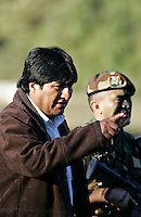 Tarija, Bolivia<br /> A picture dated Saturday, July 8, 2006 shows Bolivian President Evo Morales talking with the Commander of the School of Bolivian Commandos, Colonel Ariñez in a ceremony in the southeast region of Bolivia.
