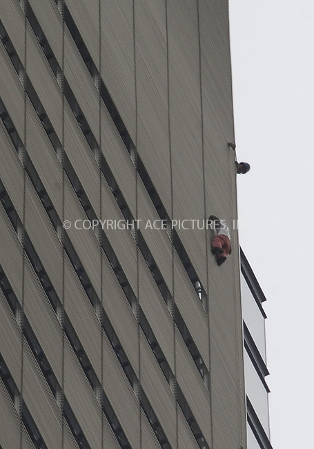 WWW.ACEPIXS.COM . . . . . ....June 5 2008, New York City....Several hours after Alain Robert, a French stuntman, climbed 52 stories up the exterior of the New York Times building and was arrested by police, a second man scaled the building on the southwestern corner facing West 40th Street. He reached the roof at around 6:38 p.m. and was arrested by firefighters and police officers.....Please byline: KRISTIN CALLAHAN - ACEPIXS.COM.. . . . . . ..Ace Pictures, Inc:  ..(646) 769 0430..e-mail: info@acepixs.com..web: http://www.acepixs.com