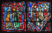 Fulbert welcomed at Chartres by bishop Odo (left) after completing his studies at Reims, and Fulbert meets the Pope (right) with the crossed keys indicating the successor of St Peter, from the Life of Fulbert stained glass window, in the south transept of Chartres Cathedral, Eure-et-Loir, France. This window replaces the original 13th century window depicting the Life of St Blaise, which was destroyed in 1791. It was created in 1954 by Francois Lorin as a gift of the Institute of American Architects, on a theme chosen by the Canon Yves Delaporte. It depicts the life of Fulbert, bishop of Chartres in the 11th century. Chartres cathedral was built 1194-1250 and is a fine example of Gothic architecture. Most of its windows date from 1205-40 although a few earlier 12th century examples are also intact. It was declared a UNESCO World Heritage Site in 1979. Picture by Manuel Cohen