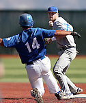 Salt Lake Community College shortstop JC Snyder turns a double play against Western Nevada's Connor Klein during a college baseball game in Carson City, Nev., on Friday, March 1, 2013. SLCC won the first game 3-2..Photo by Cathleen Allison/Nevada Photo Source