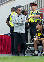 July 20, 2013: Columbus Crew head coach Robert Warzycha watches the action during a game between Toronto FC and the Columbus Crew at BMO Field in Toronto, Ontario Canada.<br /> Toronto FC won 2-1.
