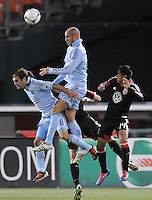 Sporting Kansas City midfielder Graham Zusi (8) heads the ball. Sporting Kansas City defeated D.C. United  1-0 at RFK Stadium, Saturday March 10, 2012.