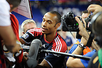 Thierry Henry (14) of the New York Red Bulls signs autographs after the game. Tottenham Hotspur F. C. defeated the New York Red Bulls 2-1 during a Barclays New York Challenge match at Red Bull Arena in Harrison, NJ, on July 22, 2010.