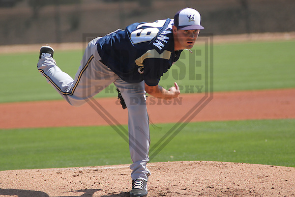 GLENDALE - March 2013: Taylor Jungmann  of the Milwaukee Brewers during a Spring Training game against the Los Angeles Dodgers on March 22, 2013 at Camelback Ranch in Glendale, Arizona.  (Photo by Brad Krause).