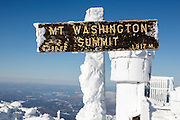 Summit sign on the summit of Mount Washington in the White Mountains, New Hampshire during the winter months. Mount Washington, at 6,288 feet, is the tallest mountain in the northeastern United States.