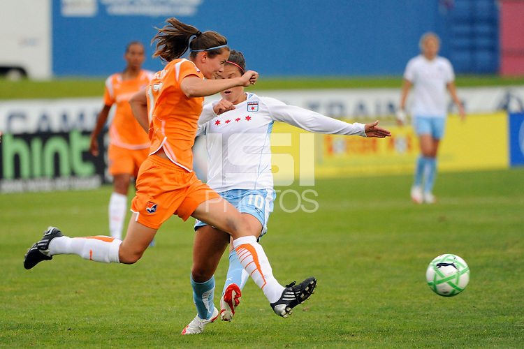 Keeley Dowling (17) of Sky Blue FC steals the ball from Carli Lloyd (10) of the Chicago Red Stars. Sky Blue FC defeated the Chicago Red Stars 1-0 during a Women's Professional Soccer match at Yurcak Field in Piscataway, NJ, on June 17, 2009.
