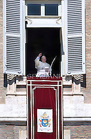 Pope Francis shows a bible from the window of the apostolic palace St.Peter's square during his Sunday Angelus prayer at the Vatican..October 5, 2014
