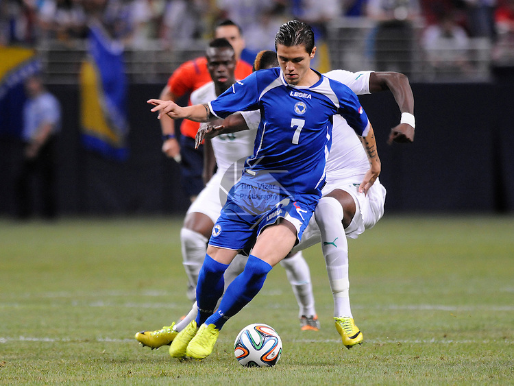 Soccer - International Friendly - Bosnia- Ivory Coast.<br /> Bosnia's Muhamed Besic (7) controls the ball as he's covered from behind by Ivory Coast players in first half action. Bosnia played Ivory Coast in an international friendly game during &quot;The Road To Brazil&quot; series. The game was played at the Edward Jones Dome in St. Louis, Missouri on Friday May 30, 2014.