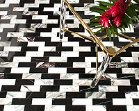 Ziggurat Grand, a stone hand-cut mosaic, shown in polished Plumeria and Nero Marquina, is part of the Tissé™ collection for New Ravenna.