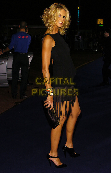 ELLE MACPHERSON.At the Giorgio Armani RED One Night Only .Fashion & Music Party, Earls Court, .London, England, September 21st 2006..full length black dress fringed tassles tanned side.Ref: CAN.www.capitalpictures.com.sales@capitalpictures.com.©Can Nguyen/Capital Pictures