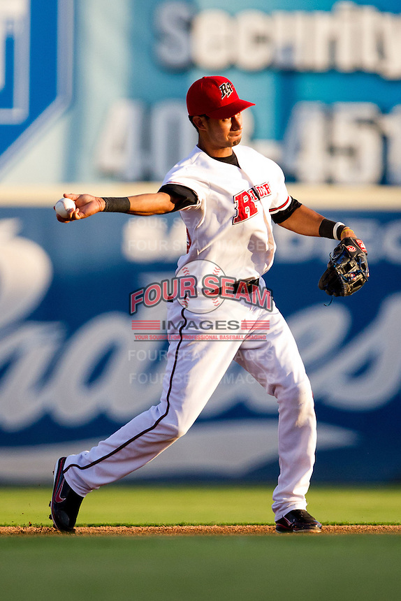 Renny Osuna (13) of the Frisco RoughRiders throws to first base during a game against the North All-Stars 2011 in the Texas League All-Star game at Nelson Wolff Stadium on June 29, 2011 in San Antonio, Texas. (David Welker / Four Seam Images)..