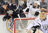 San Antonio Rampage's Scott Timmins, right, puts Oklahoma City Barons' Tyler Pitlick into the glass during the second period of an AHL hockey game, Friday, May 11, 2012, in San Antonio. (Darren Abate/pressphotointl.com)