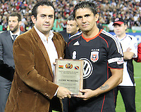 Jaime with representative of the Bolivian Embassy during festivities surrounding the final appearance of Jaime Moreno in a D.C. United uniform, at RFK Stadium, in Washington D.C. on October 23, 2010. Toronto won 3-2.