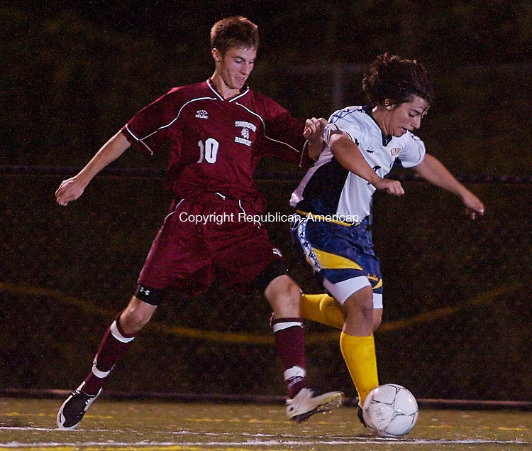 WATERBURY, CT--25 September 07--092507TJ07 - Charles Nader, left, of Torrington, nudges Dillion Costa, of Kennedy, away from the ball during John F. Kennedy High School's 2-1 win against Torrington High School on Tuesday, September 25, 2007. T.J. Kirkpatrick/Republican-American