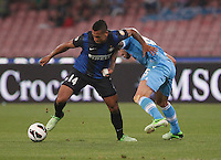 inter's  Freddy Guarin a Napoli's   Valon Behrami fight for the ball during their Italian Serie A soccer match at the San Paolo stadium in Naples.  NAPOLI 05/05/2013 -.CALCIO SERIE A 2012/2013 . NAPOLI - INTER - .NELLA FOTO  FREDY GUARIN.FOTO CIRO DE LUCA