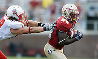 TALLAHASSEE, FL 10/31/09-FSU-NCST FB09 CH18-Florida State's Lonnie Pryor pulls in a pass as N.C. State's Shea McKeen closes during first half action Saturday at Doak Campbell Stadium in Tallahassee. .COLIN HACKLEY PHOTO