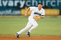Second baseman Daniel Pertusati #12 of the Jupiter Hammerheads tracks a fly ball against the Charlotte Stone Crabs at Roger Dean Stadium June 16, 2010, in Jupiter, Florida.  Photo by Brian Westerholt /  Seam Images