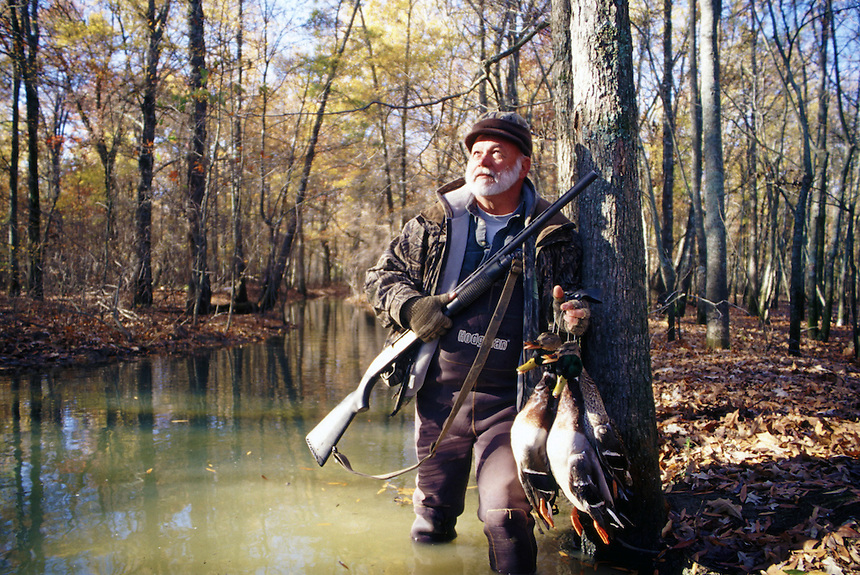 Duck hunter with mallards in fall woods, Poor Boy Club, Humnoke, Arkansas