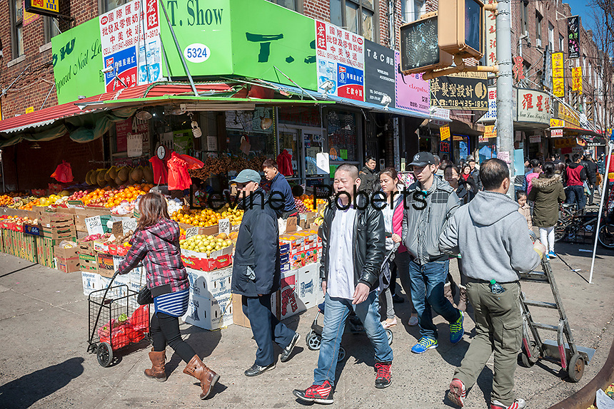 Thousands of people on Eighth Avenue in the Sunset Park neighborhood in Brooklyn in New York on Sunday, February 28, 2016 during the Lantern Festival street fair. Sunset Park has become Brooklyn's Chinatown as Chinese and other Asian groups have moved there and businesses have sprouted up to cater to them. (© Richard B. Levine)