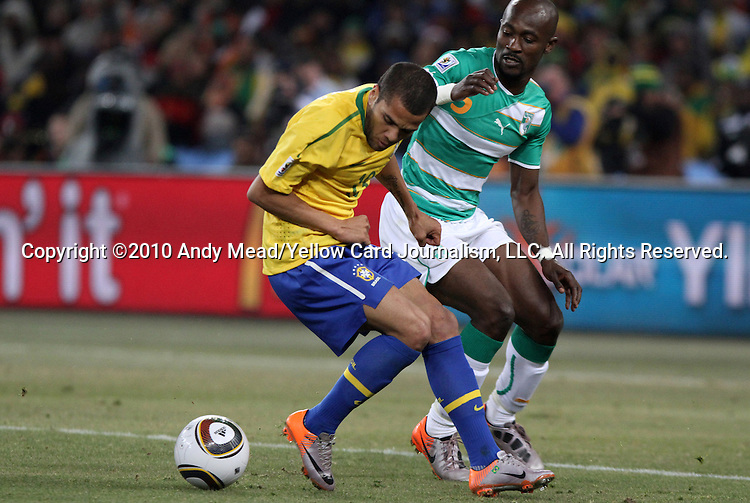 20 JUN 2010: Dani Alves (BRA) (left) and Didier Zokora (CIV) (5). The Brazil National Team defeated the C'ote d'Ivoire National Team 3-1 at Soccer City Stadium in Johannesburg, South Africa in a 2010 FIFA World Cup Group G match.