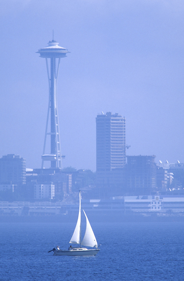 Sail boat in Elliott Bay with the Seattle Space Needle in background, Seattle, Washington