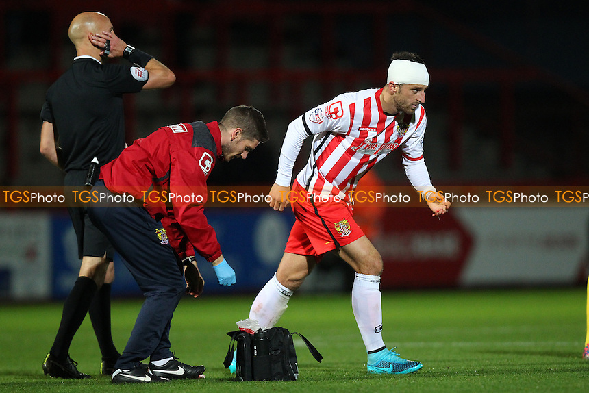 Chris Whelpdale of Stevenage with a bandage for a head injury during Stevenage vs Dagenham and Redbridge, Johnstone's Paint Trophy Football at the Lamex Stadium, Stevenage, England on 07/10/2015