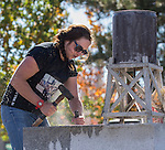Emma Baker competes in the single jack rock drilling contest during the Nevada Day activities in Carson City on Saturday, October 29, 2016.