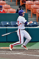 Catcher Chris Okey (25) of the Clemson University Tigers bats in a game against the Wofford College Terriers on Tuesday, March 1, 2016, at Doug Kingsmore Stadium in Clemson, South Carolina. Clemson won, 7-0. (Tom Priddy/Four Seam Images)