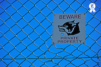 Private property warning sign on fence (Licence this image exclusively with Getty: http://www.gettyimages.com/detail/94433119 )