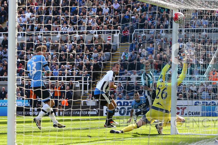 Tottenham's Erik Lamela scores his sides first goal during the Barclays Premier League match at St James' Park. Photo credit should read: Philip Oldham/Sportimage
