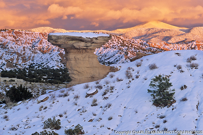 Camel Rock, a familiar landmark just north of Santa Fe, is given a glamorous farewell by the setting sun and the alpenglow from the Sangre de Cristo Mountains at the end of a winter day.