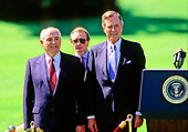 United States President George H.W. Bush, right, hosts President Mikhail Gorbachev of the Union of Soviet Socialist Republics, left, during a state arrival ceremony on the South Lawn of the White House in Washington, DC on Thursday, May 31, 1990.  It was the start of three days of talks between the two leaders.<br /> Credit: Ron Sachs / CNP