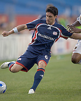 Jay Heaps (Revolution, blue) crosses. New England Revolution played Real Salt Lake to a 0-0 tie, at Gillette Stadium on June 2, 2007.