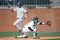 Charlotte 49ers catcher Nick Daddio (20) waits for a throw as CJ Chatham (10) of the Florida Atlantic Owls scores a run at Hayes Stadium on March 14, 2015 in Charlotte, North Carolina.  The Owls defeated the 49ers 8-3 in game one of a double header.  (Brian Westerholt/Four Seam Images)